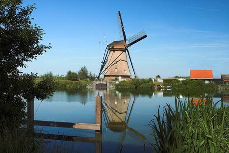dike: Dutch windmill alongside a dike
