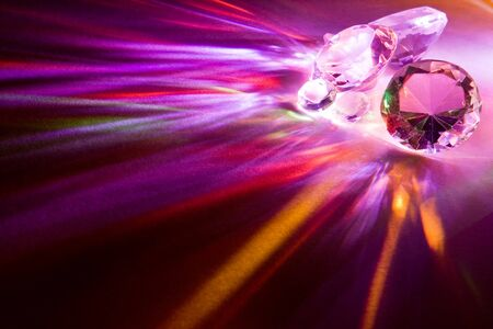 Light dispersed through fake diamonds giving fascinating colors photo