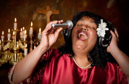 Woman singing a hymn photo