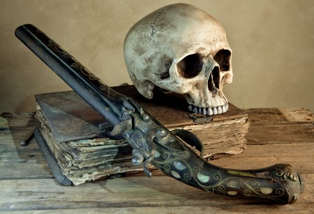 Vintage photo of a skull and pistol as in an old master painting photo
