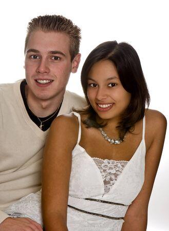 origin: Loving couple of different ethnic origin, posing on white Stock Photo