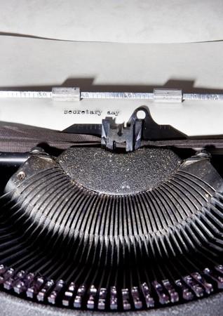 Antique typewriter typing Secretary Day on paper Stock Photo - 4539434