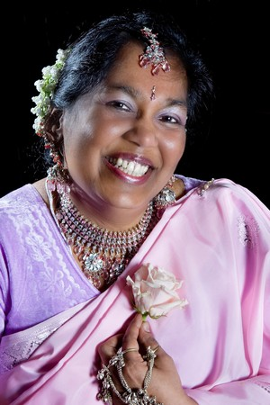 Happy Indian woman wearing a pink silk saree photo