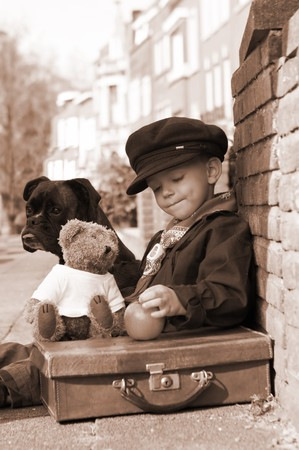 vintage children: Vintage photo of a little boy and his dog Stock Photo
