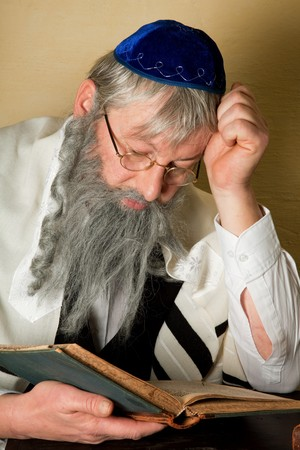 sephardi: Old jewish man with beard reading a book