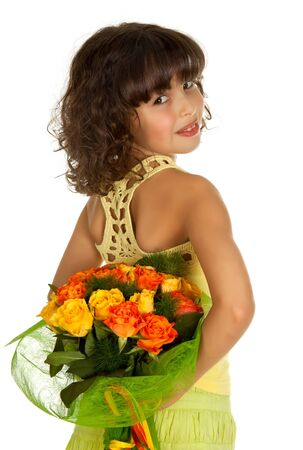 Little girl hiding flowers for mother's day Stock Photo - 4561823