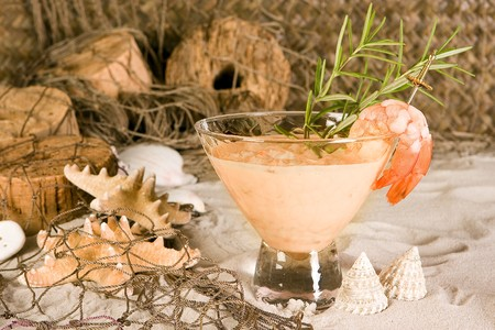 floaters: Shrimp cocktail on a fishing net or beach background Stock Photo