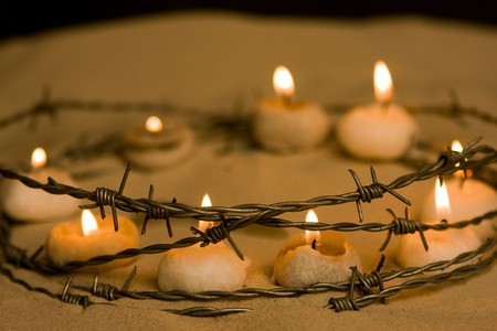 Burning candles in barbed wire, symbol of hope and civil rights Stock Photo - 4566766