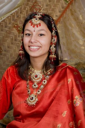 Indian lady wearing traditional sari and bridal jewelry photo