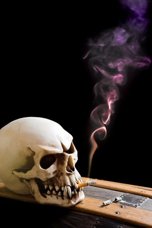 Smoking skull on its coffin