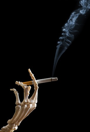 Skeleton hand holding a cigarette Stock Photo - 4566718