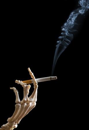 Skeleton hand holding a cigarette Stock Photo - 4566718