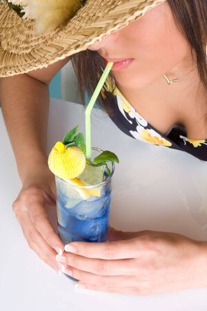 Young beauty drinking a cocktail with a straw Stock Photo - 4610235