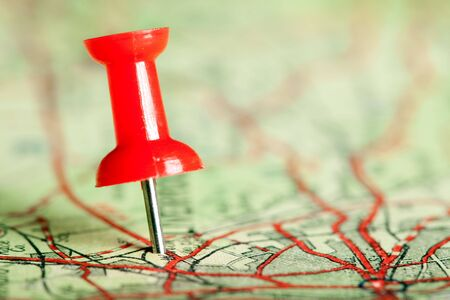 red pushpin: Red pushpin on a tourist map for travelling Stock Photo