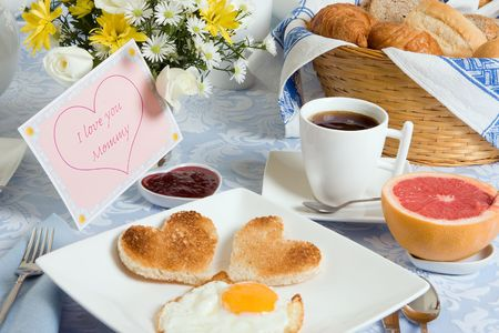 Mothers day breakfast with eggs and heart shaped toast