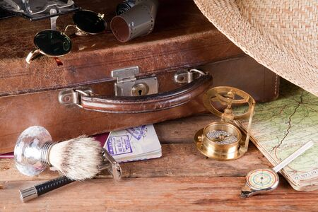 Vintage suitcase, maps, compass and distance meter Stock Photo - 4657113