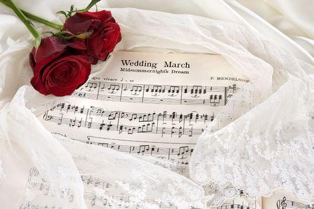 歌: バラとブライダル ベール ウエディング マーチのシート音楽 写真素材