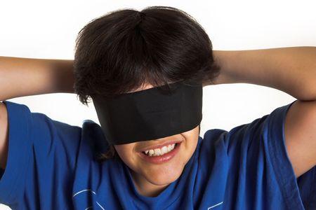 blind child: Boy with blindfolding scarf