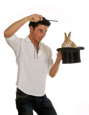 Young man showing a rabbit in a top hat photo