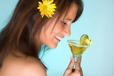 Young woman drinking a yellow summer cocktail Stock Photo - 4691413
