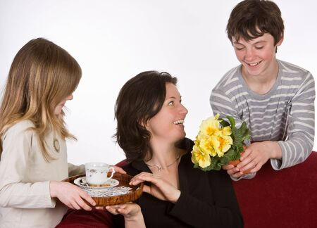 Mother receiving coffee and flowers on mothers day photo
