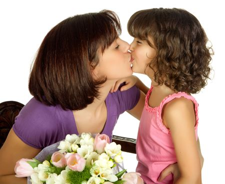 women kissing: Happy mother kissing her daughter on mothers day Stock Photo