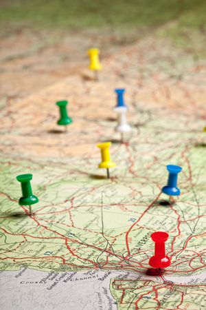 roadmap: Colored pushpins on a road map of a tourist Stock Photo