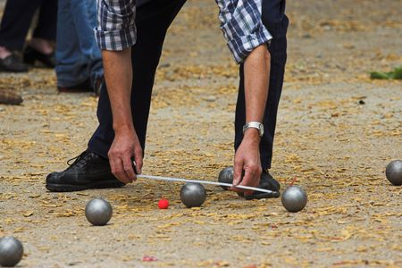 boules: Petanque game in France, measuring the distance, deciding whos the winner Stock Photo