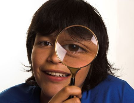 giggle: Boy looking through a magnifying glass