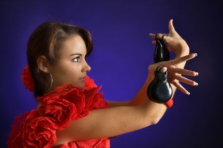 Young Spanish flamenco dancer playing the castanets