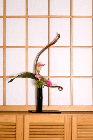 ikebana: Ikebana flower arrangement in a japanese interior against an authentic shoji sliding window