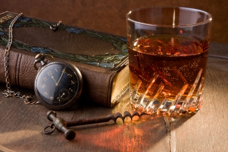aperitive: A good book and a glass of whisky Stock Photo
