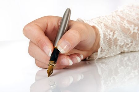 Elegant hand writing with a gold fountain pen photo
