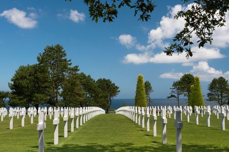 a memorial to fallen soldiers: Graves overlooking the atlantic ocean at the American cemetery in Normandy, France Stock Photo