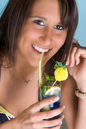 Attractive young woman drinking a blue cocktail with a straw Stock Photo - 4912509