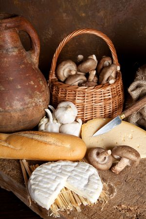 Vintage still life of country food and an antique wine jar photo