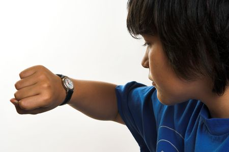 checking: Boy looking at his wrist watch