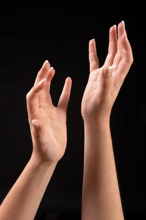 Two female hands reaching upwards in an elegant position
