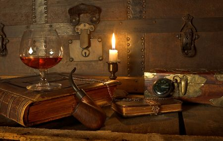 wood burning: A good old book, a glass of cognac and my pipe Stock Photo