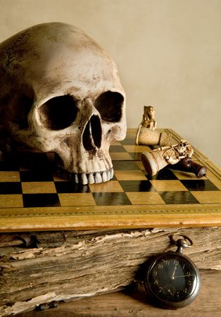 watch over: Vintage image with skull on an antique checkboard Stock Photo