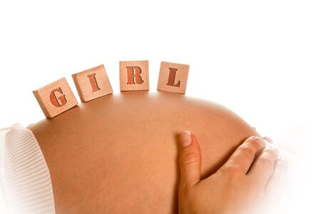 Little wooden building blocks on pregnant belly with space for baby name Stock Photo - 4944296