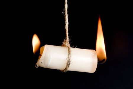 Candle burning on two sides, as a metaphor for burn-out