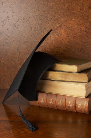 graduate hat: Still life with graduation cap and books Stock Photo
