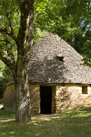 drystone: Old stone huts in the village of Breuil, Dordogne, France Stock Photo