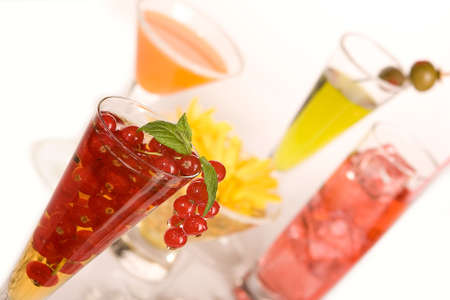 Colored cocktails, one with fresh red berries Stock Photo - 4967716