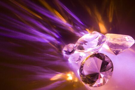 Light dispersing into two colors through glass with facets Stock Photo - 4967748