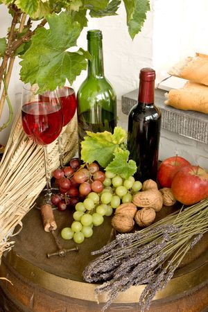 wine country: Wine barrel with fruits, red wine and bread Stock Photo