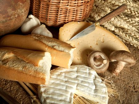 Vintage meal of French cheese, baguette bread and mushrooms photo