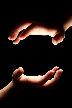 Hands almost touching eachother in the dark Stock Photo - 5084797