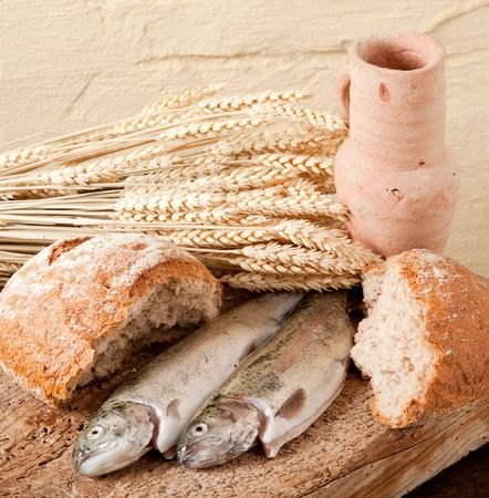 , wheat, bread and fish as symbols of religion photo